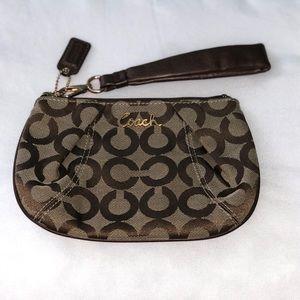 COACH Signature Wristlet. Leather strap